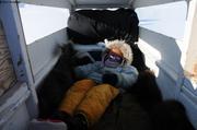 Aurore sieste dans traineau